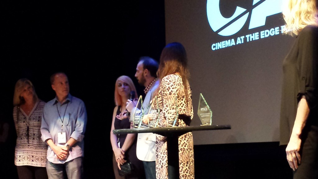 Dir. Kyle Broom and Prod. Alex Spector accept the Audience Award
